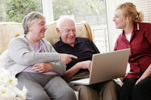bigstockphoto_elderly_couple_and_care_worker_3593583